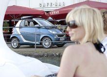 """转推 //<a href=""""http://tui.etao.com/tuitui"""">推推网:</a>盘点十款让女人一见倾心的小车~~"""